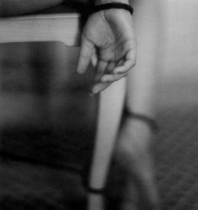tied to chair b and w pic